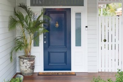 A blue door welcomes the home visits from the physiotherapist