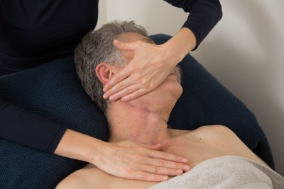 Gentle physiotherapy manipulation on older patient