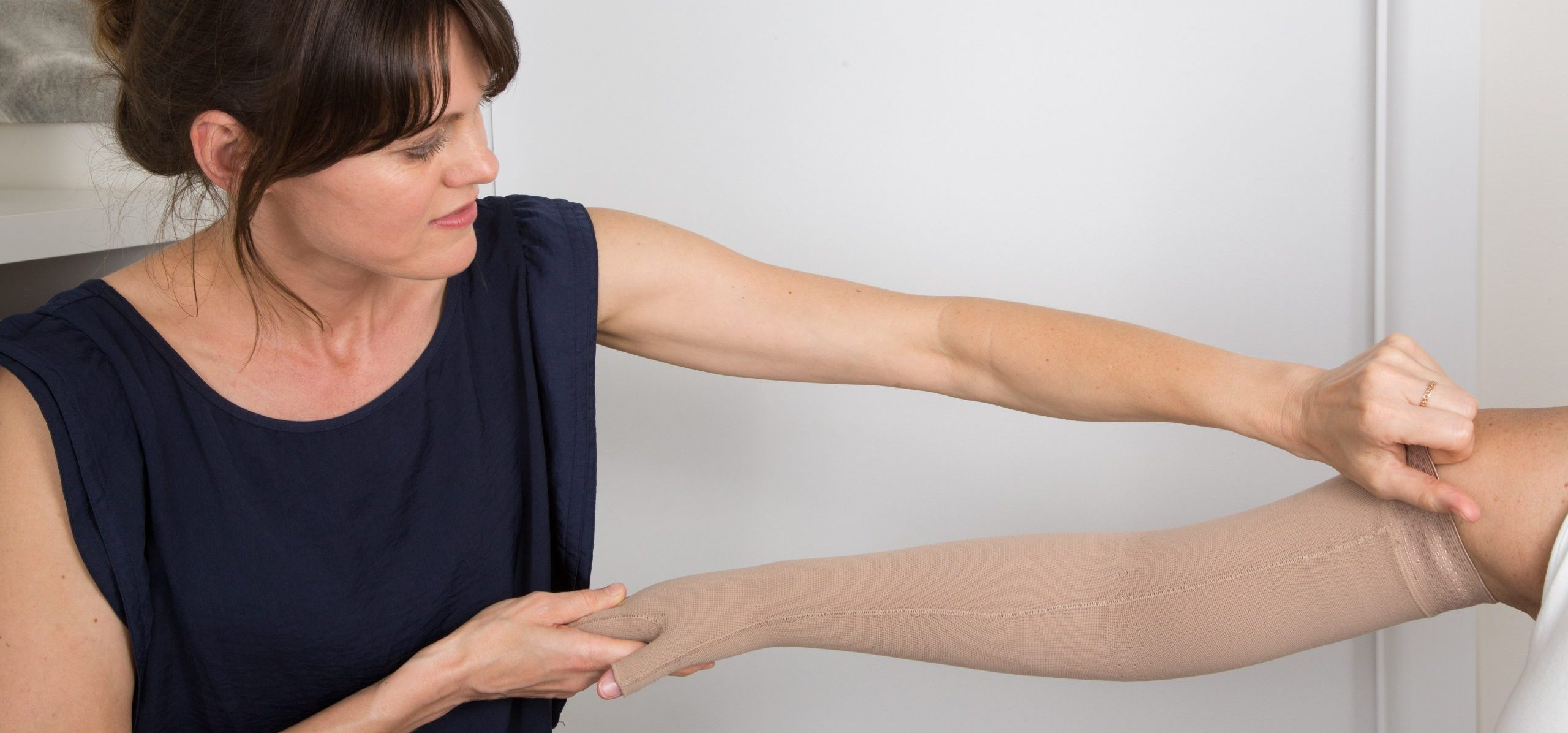 Oncology Recovery Services - Orsi ensuring armband fits a client
